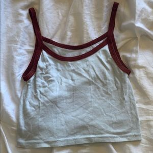 cropped blue tank with red straps